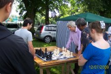 Peter Broomhall playing with  giant chess set.  Colin Haughton on right pondering at Wolverhampton Show Sun 12 July 2009